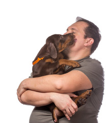 Adult man is holding his sweet puppy isolated on white backgroun