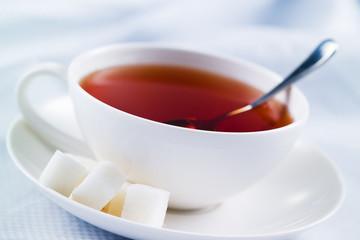 Black tea with sugar cubes. Macro