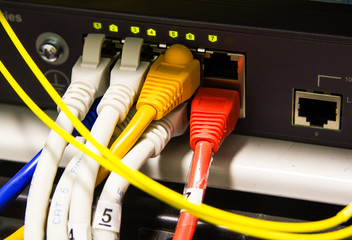 UTP Network cables connected to an Fast/Giga ethernet ports