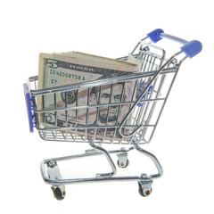 Shopping cart and American Dollars isolated on white