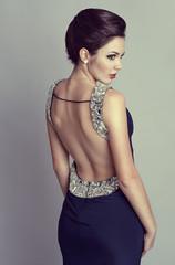 Party styling woman. Beautiful brunette in luxury dress