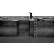 Businessman gazing on top of 3D concrete maze structure
