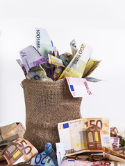 Money bag with euro notes and coins