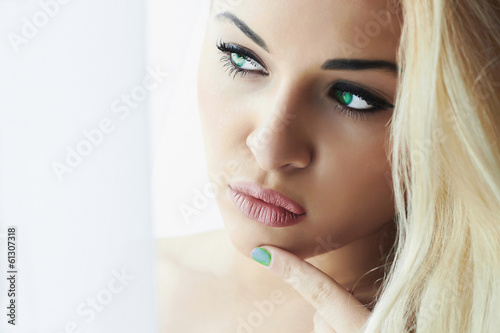 Beautiful Face of Young Blond Woman.Look in Window
