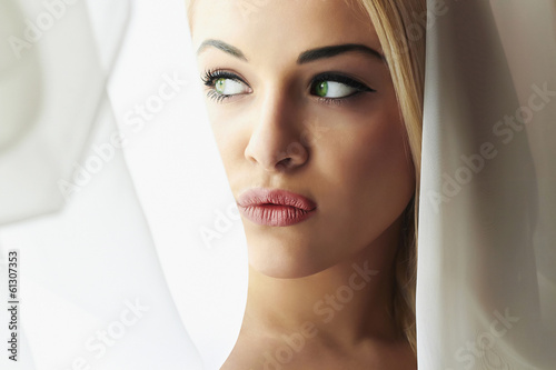 Beautiful Young Blond Bride Woman. Look in Window.Мeil. Curtains