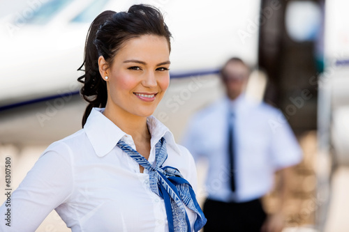 Stewardesses Smiling With Pilot And Private Jet In Background