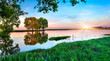 Spring panorama of morning with rising sun on lake - 61307769