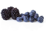 Macro of blackberries and currant berries over white background