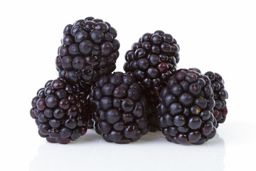 Macro of pile blackberries over white background