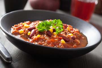 mexican chili con carne in black plate