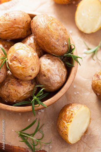 baked potatoes in wooden bowl