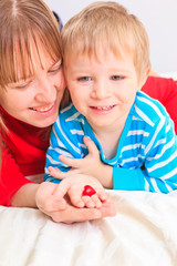 mother and son holding heart