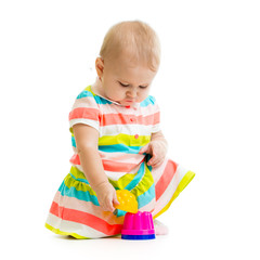 child is playing with toys