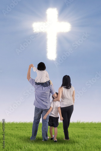 Christian family with a cross