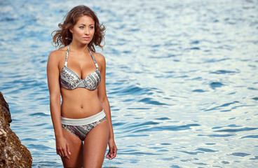 Beautiful model relaxing on a beach