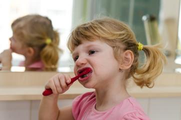 child brushing teets