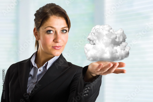 Woman holding a cloud in her hand