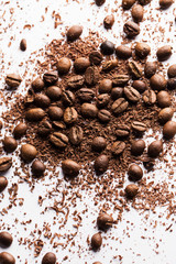 Coffee beans and particles of black chocolate