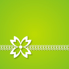 green background with a lace and a flower