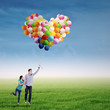 Couple Flying with Balloons