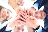 Small group of business people joining hands poster