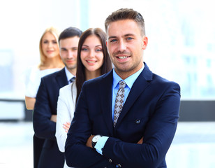 business people standing together in line in a modern office