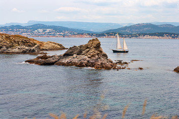 Boat with sails near the island. Provence. France