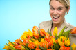 Cheerful woman with colorful spring tulips