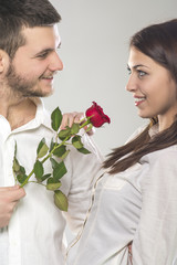 Young man giving rose to his girlfriend