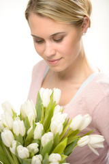 Lovely woman looking down white tulip flowers