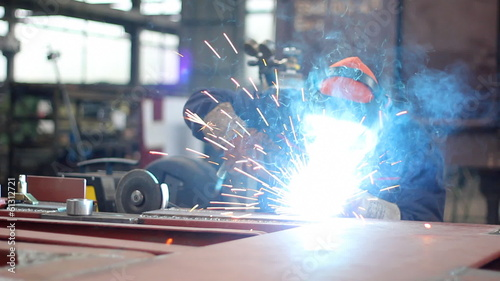 Steel worker welding in metal industry