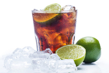 Fresh cocktail with cola drink and lime