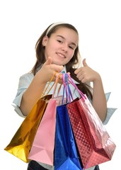 Teen girl with multicolored packages in hands rejoices purchases