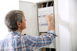 Technician checking on electric box in private home