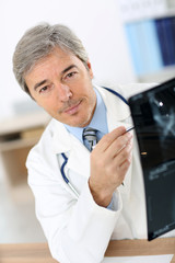 Doctor checking on X-ray results