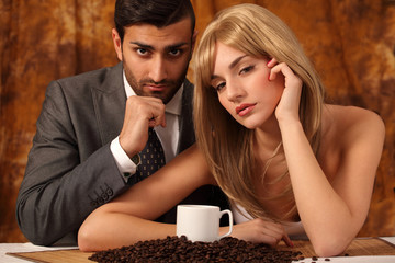Sensual couple and the delight of coffee