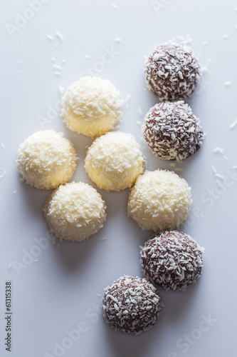 Chocolate candies with coconut flakes