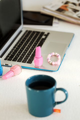 Laptop, mug and nail polish