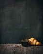coffee and croissant on blackboard background. copy space - 61316550