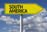 South America creative sign with clouds as the background