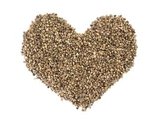 Hemp seeds shaped as a heart on white background