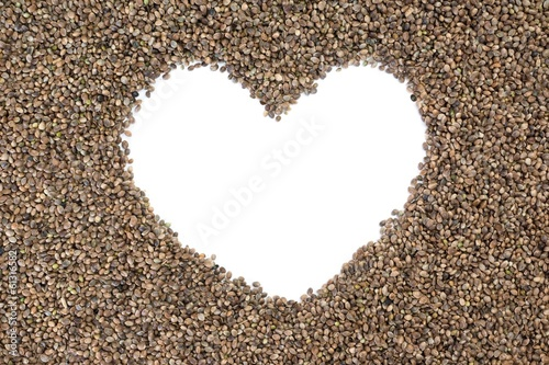 photo of hemp seeds with white heart shaped copy space