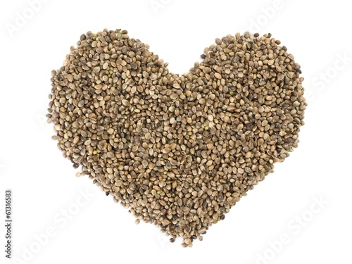 Hemp seeds shaped as a heart on white background