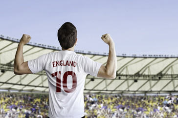 English soccer player celebrates with the fans on the stadium