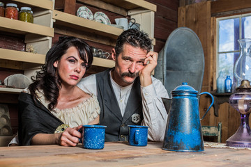 Sad Western Sheriff and Woman Pose Inside House