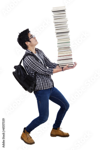 Man carrying a pile of books