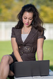 Attractive hispanic business woman working outdoor