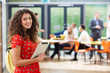 Portrait Of Female Student In Classroom With Digital Tablet