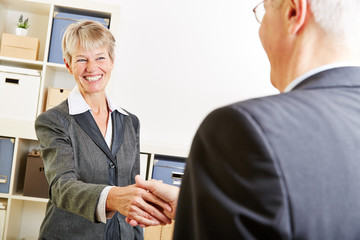 Business people greeting with a handshake