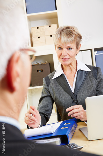 Senior man listening to female consultant
